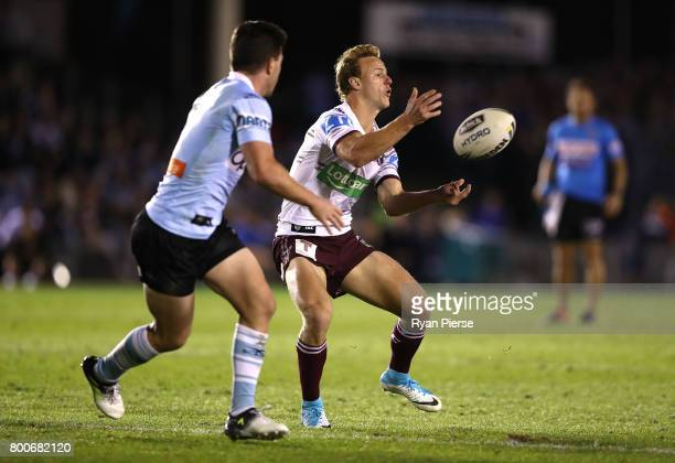 Dale CherryEvans of the Sea Eagles passes during the round 16 NRL match between the Cronulla Sharks and the Manly Sea Eagles at Southern Cross Group...