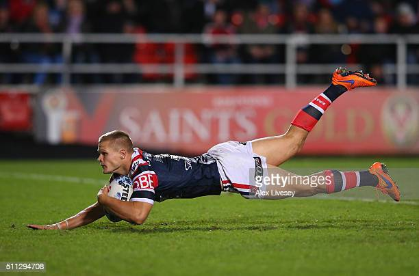 Dale Copley of Sydney Roosters dives over the line to score the fourth try during the World Club Series match between St Helens and Sydney Roosters...