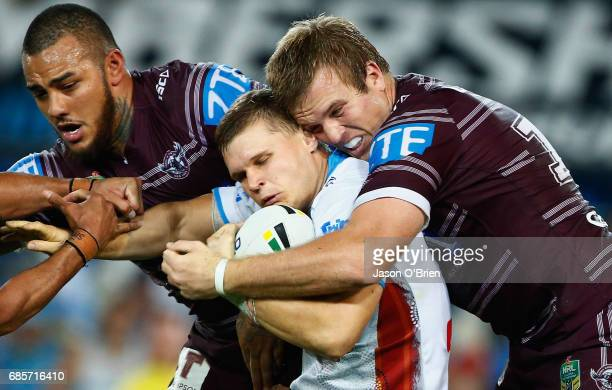 Dale Copley of the Titans is tackled by Jake Trbojevic during the round 11 NRL match between the Gold Coast Titans and the Manly Sea Eagles at Cbus...