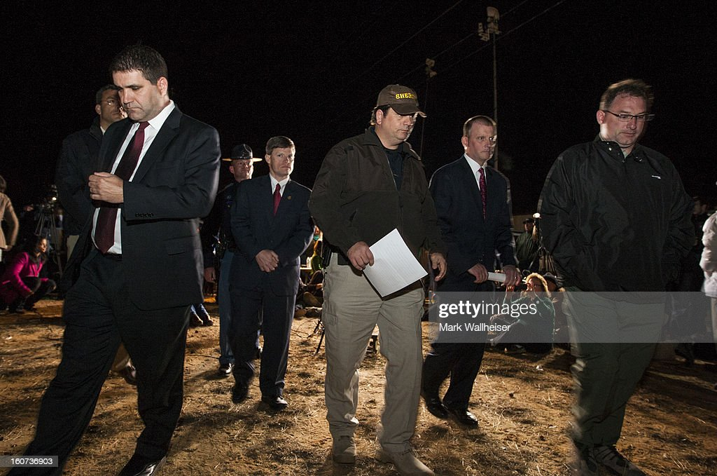Dale County Sheriff's deputies leave a press conference after talking to reporters concerning the resolution of the seven day hostage situation on February 4, 2013 in Midland City, Alabama. Officials identified the suspect as Jimmy Lee Dykes, a 65-year-old retired truck driver, who held hostage a 5-year-old boy in an underground bunker during a week long standoff with authorities.