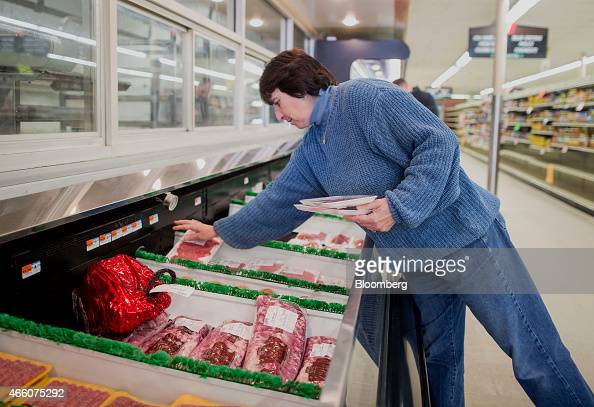Dale Danahy one of the owners of Colella's Supermarket restocks meat at the store in Hopkinton Massachusetts US on Saturday March 7 2015 At 59 Danahy...