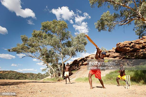 Dale Dhamarrandji from Gapuwiyak Arnhem Land in the Northern Territory plays cricket in the dry Todd River with his Miwatj Dolphins team mates during...
