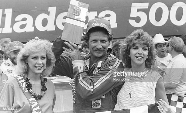 Dale Earnhardt and his wife Teresa celebrate in victory lane following the 1984 Talladega 500 on July 29 1984 in Talladega Alabama
