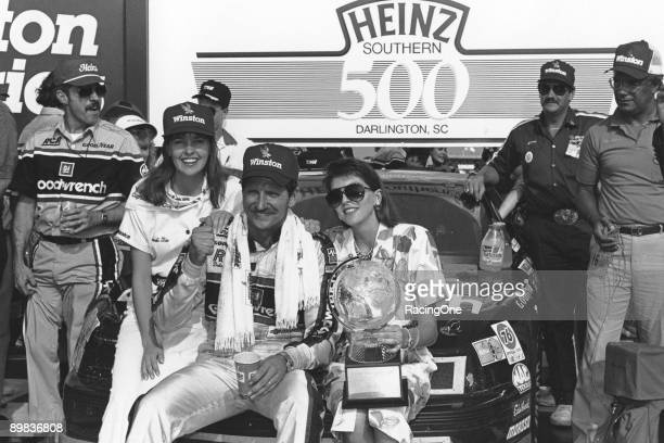 Dale Earnhardt and his wife Teresa in victory lane following Dale's victory in the Southern 500 The triumph halted Darrell Waltrip's bid to earn the...