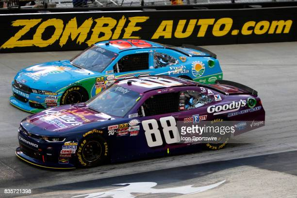 Dale Earnhardt jr and Aric Alimarola during the running of the 36th annual Food City 300 Xfinity race at Bristol Motor Speedway on August 182017