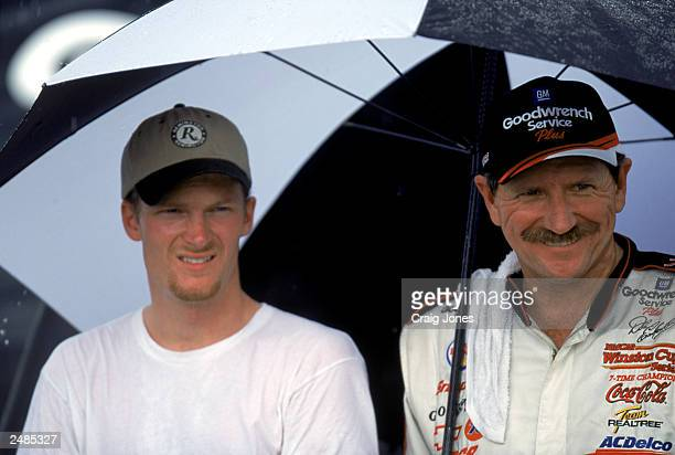 Dale Earnhardt Jr and Dale Earnhardt Sr pose for a photograph after the Pepsi Southern 500 at the Darlington Raceway on September 3 2000 in...