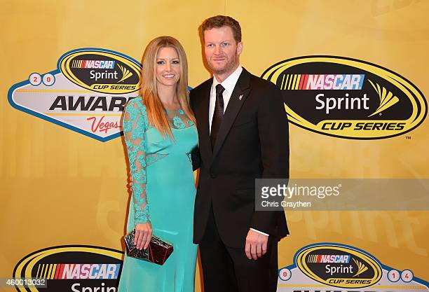 Dale Earnhardt Jr and his girlfriend Amy Reimann arrive on the red carpet prior to the 2014 NASCAR Sprint Cup Series Awards at Wynn Las Vegas on...