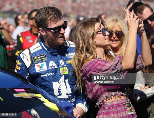 Dale Earnhardt Jr and his wife Amy Reimann share a moment beside his car before the start of the Daytona 500 on Sunday Feb 26 2017 at Daytona...