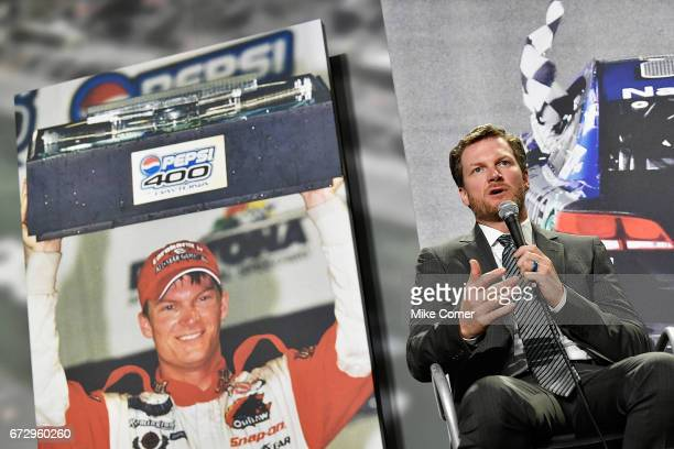 Dale Earnhardt Jr answers questions from the media during a press conference to announce his retirement from NASCAR after the 2017 season at the...