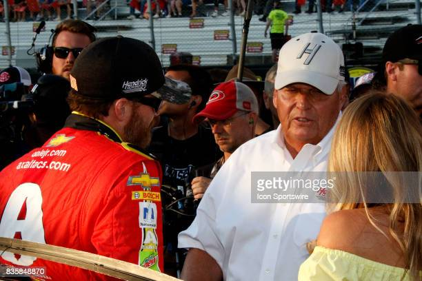 Dale Earnhardt Jr Axalta Ducks Unlimited Chevrolet SS and car owner Rick Henrick during the running of the 57th annual Bass Pro Shops NRA Night Race...