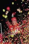 Dale Earnhardt Jr celebrates after driving his Budweiser Chevrolet car to victory at the NASCAR Winston at Lowe's Motor Speedway on May 20 2000 in...