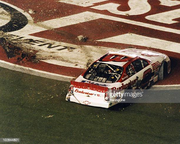 Dale Earnhardt Jr digs up the trioval grass after winning the Pepsi 400 NASCAR Cup race at Daytona International Speedway