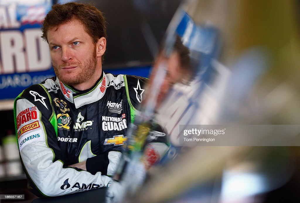 <a gi-track='captionPersonalityLinkClicked' href=/galleries/search?phrase=Dale+Earnhardt+Jr.&family=editorial&specificpeople=171293 ng-click='$event.stopPropagation()'>Dale Earnhardt Jr.</a>, driver of the #88 AMP Energy Gold / 7-Eleven Chevrolet, looks on in the garage area during practice for the NASCAR Sprint Cup Series AAA Texas 500 at Texas Motor Speedway on November 1, 2013 in Fort Worth, Texas.
