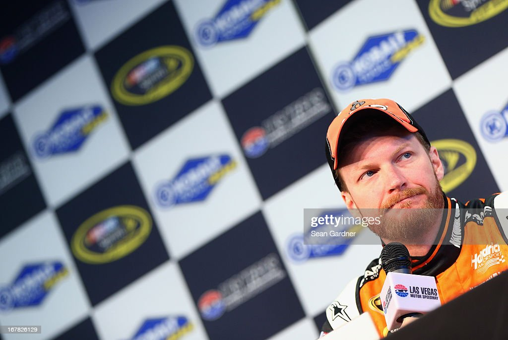 <a gi-track='captionPersonalityLinkClicked' href=/galleries/search?phrase=Dale+Earnhardt+Jr.&family=editorial&specificpeople=171293 ng-click='$event.stopPropagation()'>Dale Earnhardt Jr.</a>, driver of the #88 AMP Energy Orange Chevrolet, speaks to the media during a rain delay of practice for the NASCAR Sprint Cup Series at Las Vegas Motor Speedway on March 8, 2013 in Las Vegas, Nevada.