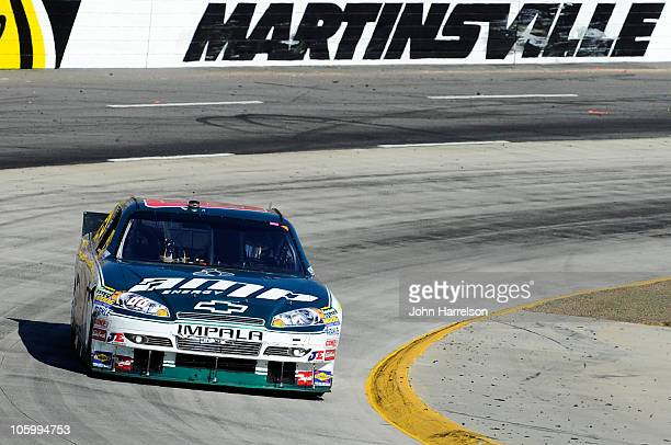 Dale Earnhardt Jr driver of the AMP Energy/National Guard Chevrolet leads the field during the NASCAR Sprint Cup Series TUMS Fast Relief 500 at...