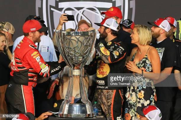 Dale Earnhardt Jr driver of the AXALTA Chevrolet congratulates Martin Truex Jr driver of the Bass Pro Shops/Tracker Boats Toyota as he celebrates...