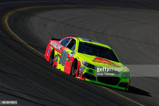 Dale Earnhardt Jr driver of the Axalta Chevrolet drives during practice for the Monster Energy NASCAR Cup Series Camping World 500 at Phoenix...