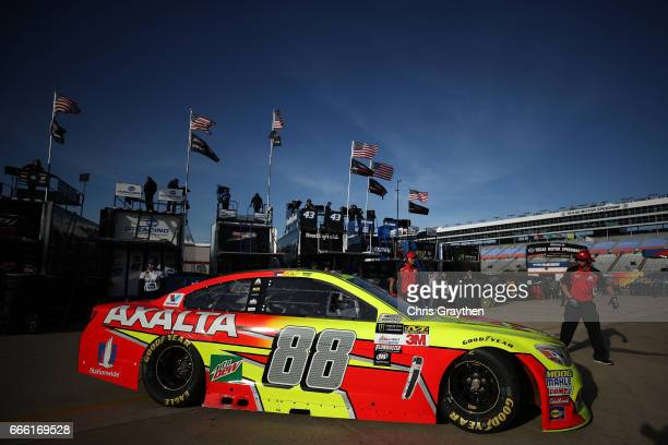 Dale Earnhardt Jr driver of the Axalta Chevrolet drives through the garage area during practice for the Monster Energy NASCAR Cup Series O'Reilly...