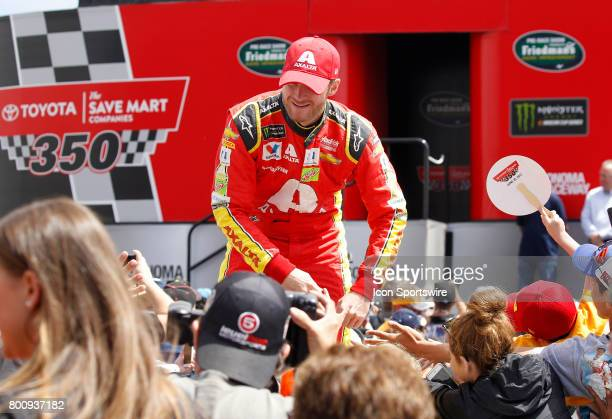 Dale Earnhardt Jr driver of the Axalta Chevrolet greets fans during prerace festivities at the NASCAR Monster Energy Cup Series Toyota/Save Mart 350...
