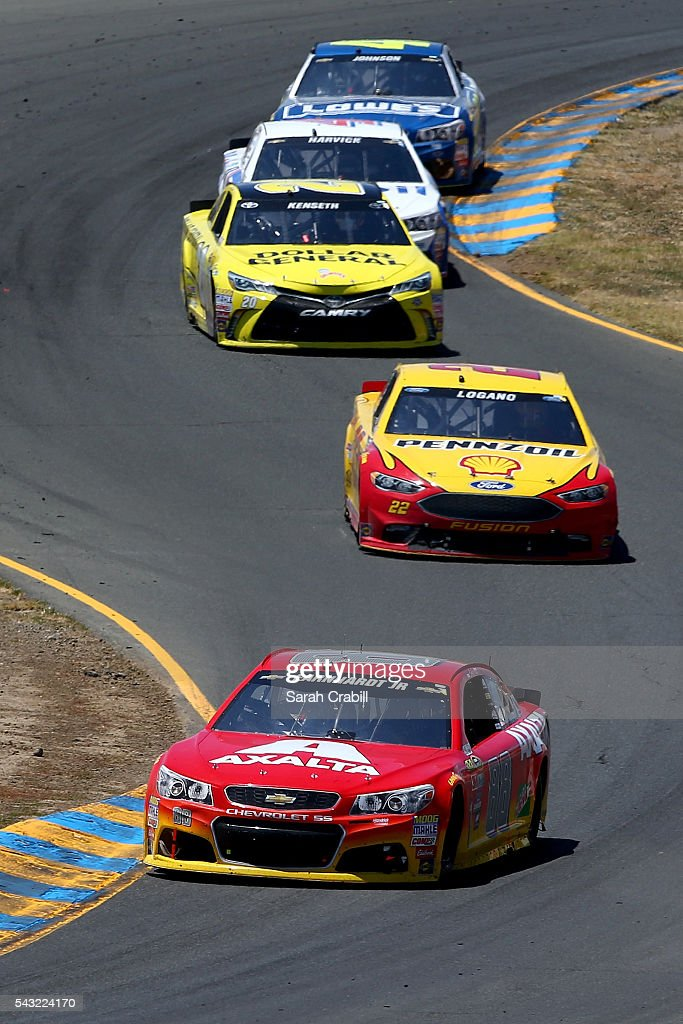 Dale Earnhardt Jr, driver of the #88 Axalta Chevrolet, leads a pack of cars during the NASCAR Sprint Cup Series Toyota/Save Mart 350 at Sonoma Raceway on June 26, 2016 in Sonoma, California.