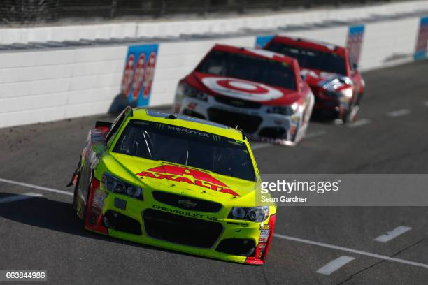 Dale Earnhardt Jr driver of the Axalta Chevrolet leads Kyle Larson driver of the Target Chevrolet during the Monster Energy NASCAR Cup Series STP 500...