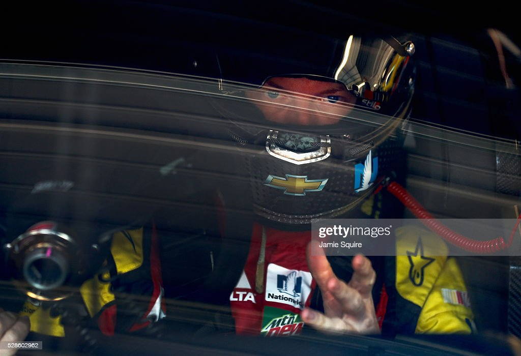 Dale Earnhardt Jr., driver of the #88 Axalta Chevrolet, looks on during practice for the NASCAR Sprint Cup Series Go Bowling 400 at Kansas Speedway on May 6, 2016 in Kansas City, Kansas.