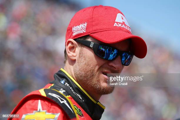 Dale Earnhardt Jr driver of the Axalta Chevrolet looks on during the Monster Energy NASCAR Cup Series STP 500 at Martinsville Speedway on April 2...