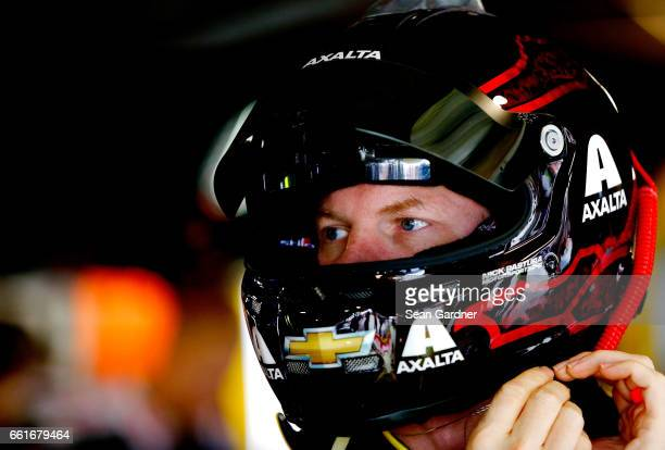 Dale Earnhardt Jr driver of the Axalta Chevrolet looks on from the garage during practice for the Monster Energy NASCAR Cup Series STP 500 at...