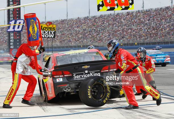 Dale Earnhardt Jr driver of the Axalta Chevrolet pits during the Monster Energy NASCAR Cup Series Auto Club 400 at Auto Club Speedway on March 26...
