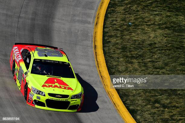 Dale Earnhardt Jr driver of the Axalta Chevrolet races during the Monster Energy NASCAR Cup Series STP 500 at Martinsville Speedway on April 2 2017...