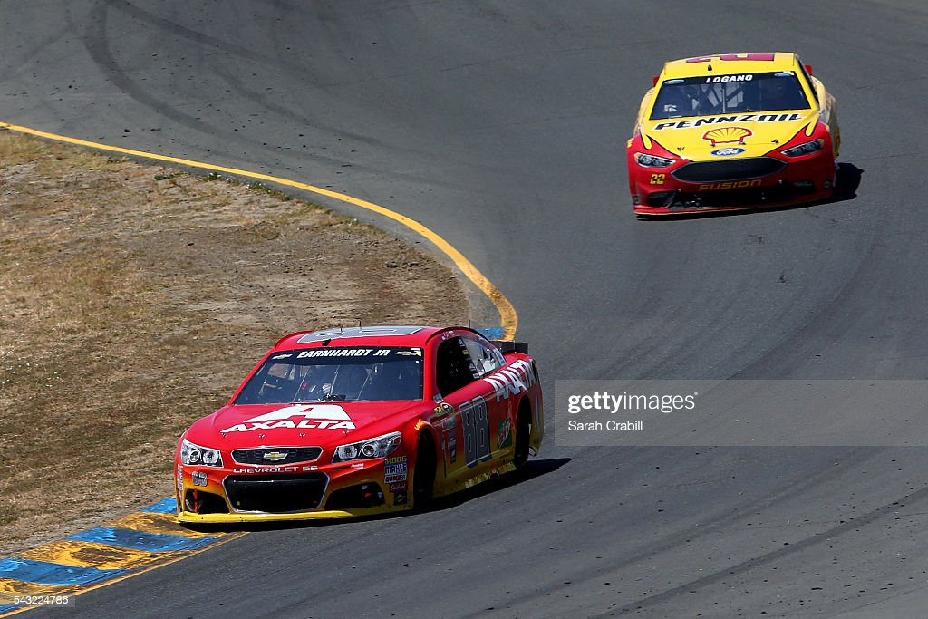 Dale Earnhardt Jr, driver of the #88 Axalta Chevrolet, races <a gi-track='captionPersonalityLinkClicked' href=/galleries/search?phrase=Joey+Logano&family=editorial&specificpeople=4510426 ng-click='$event.stopPropagation()'>Joey Logano</a>, driver of the #22 Shell Pennzoil Ford, during the NASCAR Sprint Cup Series Toyota/Save Mart 350 at Sonoma Raceway on June 26, 2016 in Sonoma, California.