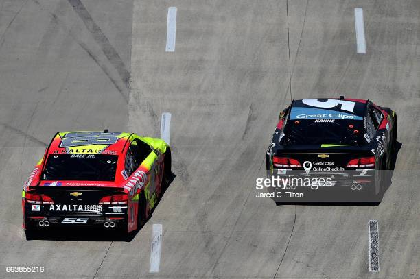 Dale Earnhardt Jr driver of the Axalta Chevrolet races Kasey Kahne driver of the Great Clips Chevrolet during the Monster Energy NASCAR Cup Series...