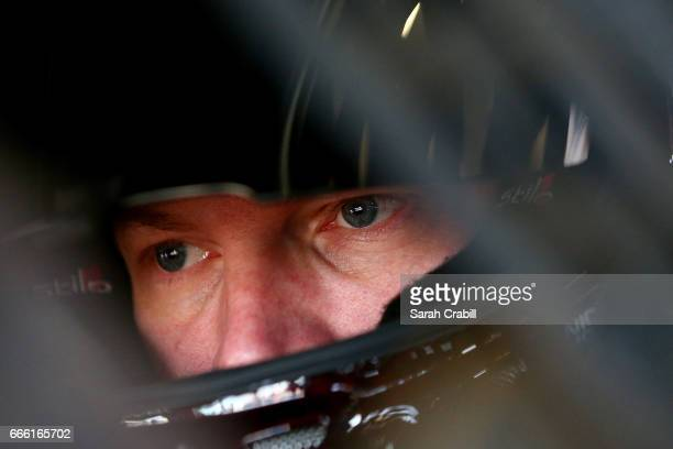 Dale Earnhardt Jr driver of the Axalta Chevrolet sits in his car during practice for the Monster Energy NASCAR Cup Series O'Reilly Auto Parts 500 at...
