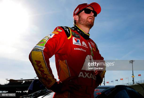 Dale Earnhardt Jr driver of the Axalta Chevrolet stands by his car during qualifying for the Monster Energy NASCAR Cup Series Camping World 500 at...