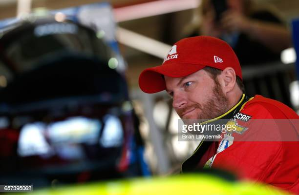 Dale Earnhardt Jr driver of the Axalta Chevrolet stands in the garage during practice for the Monster Energy NASCAR Cup Series Auto Club 400 at Auto...