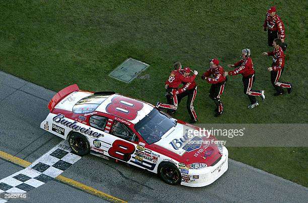 Dale Earnhardt Jr driver of the Budweiser Chevrolet is congratuated by his crew members as they celebrate following his win in the NASCAR Nextel Cup...