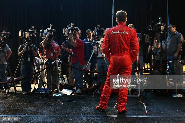 Dale Earnhardt Jr driver of the Budweiser Chevrolet speaks with members of the media during the NASCAR media day at Daytona International Speedway on...