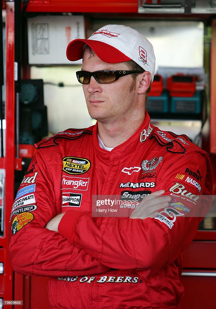 Dale Earnhardt Jr driver of the Budweiser Chevrolet stands in the garage area during practice for the NASCAR Nextel Cup Series Subway Fresh Fit 500...