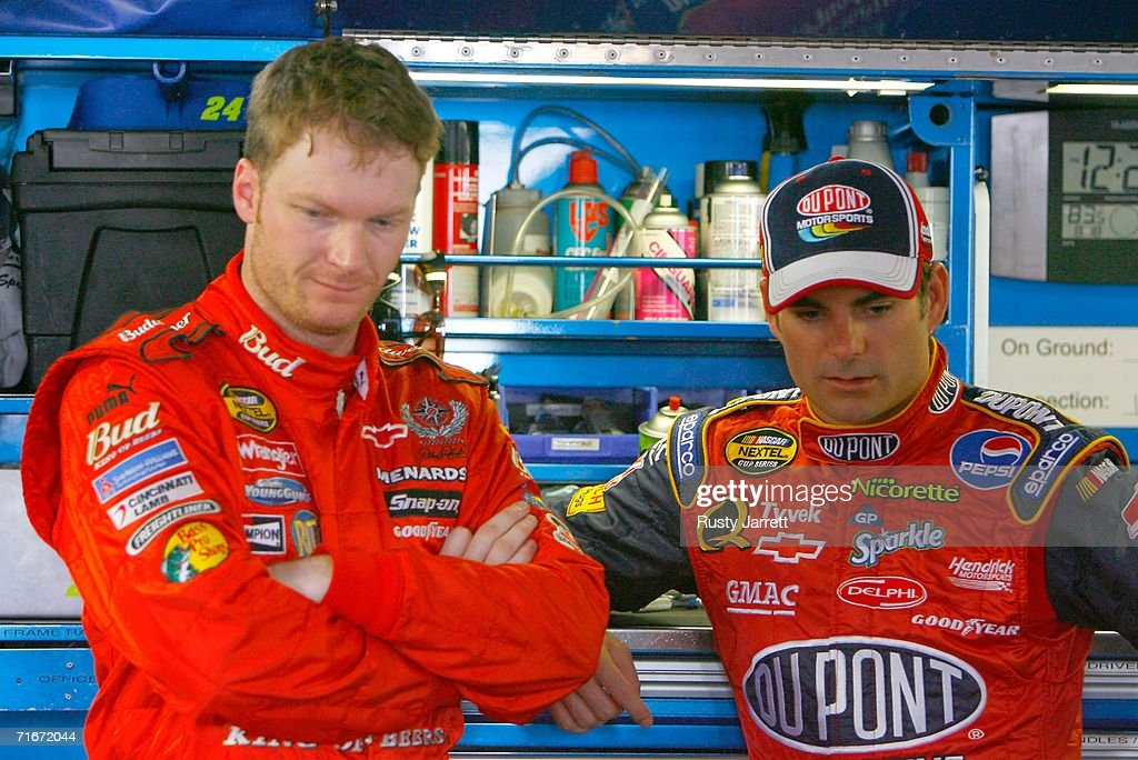 Dale Earnhardt Jr driver of the Budweiser Chevrolet talks with Jeff Gordon driver of the DuPont Chevrolet in the garage during practice for the...