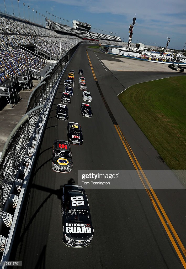Dale Earnhardt Jr., driver of the #88 Chevrolet, leads the field during the NASCAR Sprint Cup Preseason Thunder testing at Daytona International Speedway on January 11, 2013 in Daytona Beach, Florida.