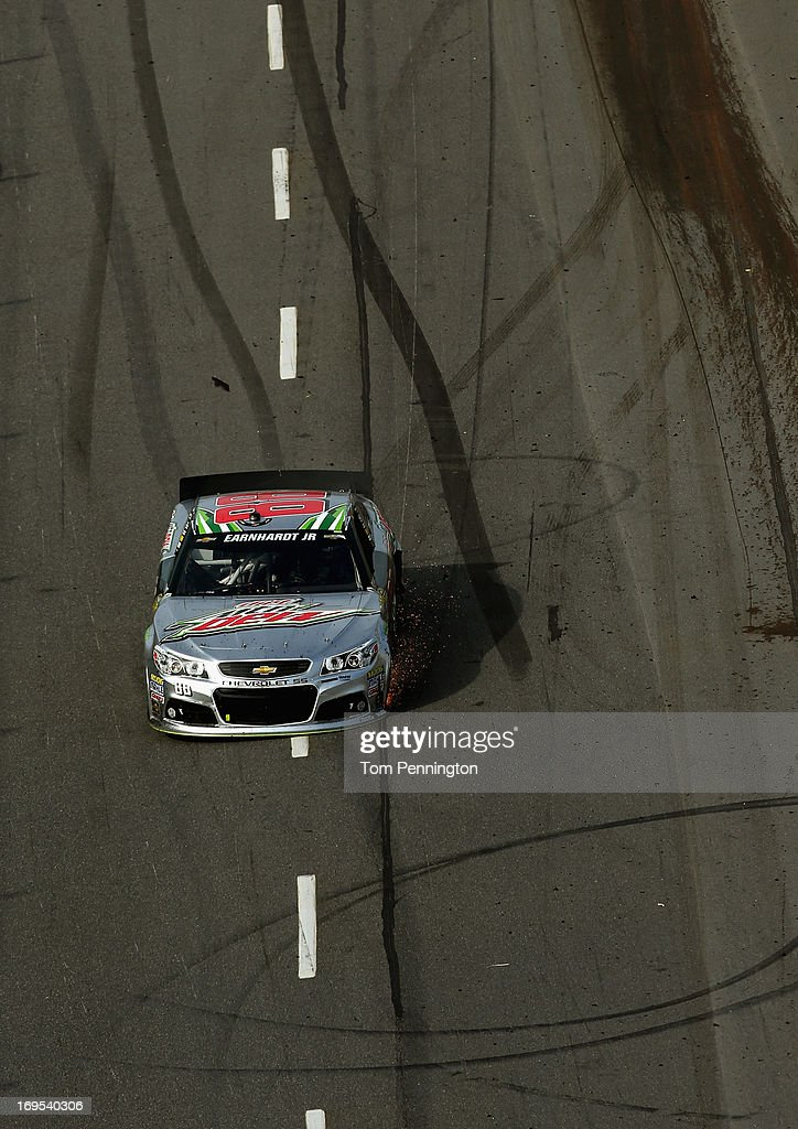Dale Earnhardt Jr., driver of the #88 Diet Mountain Dew Chevrolet, drives during the NASCAR Sprint Cup Series STP Gas Booster 500 on April 7, 2013 at Martinsville Speedway in Ridgeway, Virginia.