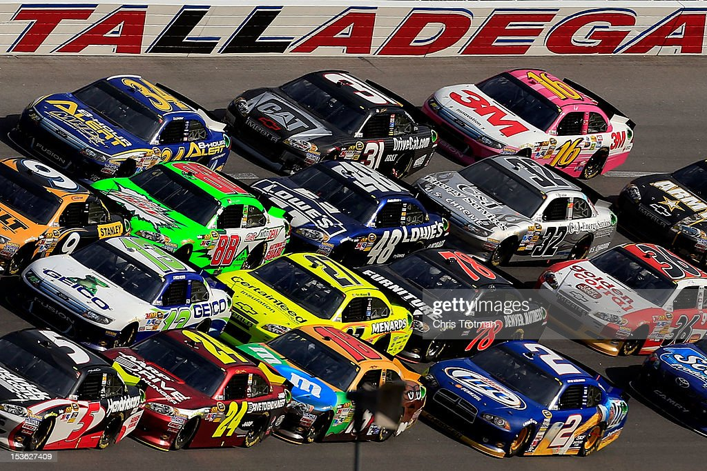 <a gi-track='captionPersonalityLinkClicked' href=/galleries/search?phrase=Dale+Earnhardt+Jr.&family=editorial&specificpeople=171293 ng-click='$event.stopPropagation()'>Dale Earnhardt Jr.</a>, driver of the #88 Diet Mountain Dew Chevrolet, gets bump drafted by <a gi-track='captionPersonalityLinkClicked' href=/galleries/search?phrase=Jimmie+Johnson+-+Nascar+Race+Driver&family=editorial&specificpeople=171519 ng-click='$event.stopPropagation()'>Jimmie Johnson</a>, driver of the #48 Lowe's Chevrolet, in a pack of cars during the NASCAR Sprint Cup Series Good Sam Roadside Assistance 500 at Talladega Superspeedway on October 7, 2012 in Talladega, Alabama.