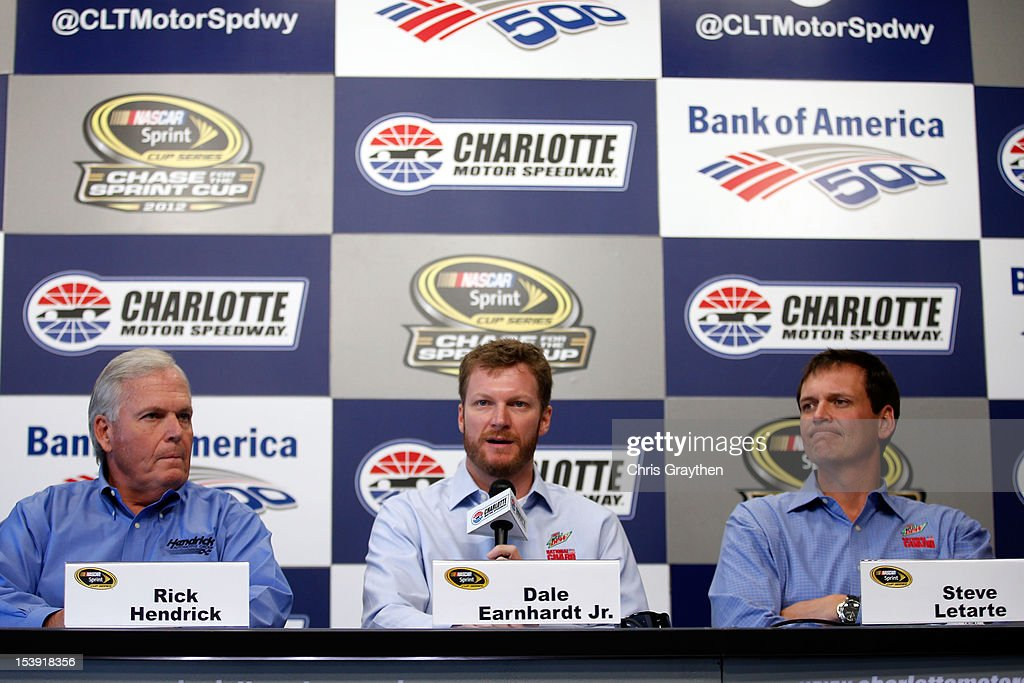 <a gi-track='captionPersonalityLinkClicked' href=/galleries/search?phrase=Dale+Earnhardt+Jr.&family=editorial&specificpeople=171293 ng-click='$event.stopPropagation()'>Dale Earnhardt Jr.</a> (C), driver of the #88 Diet Mountain Dew Chevrolet, is flanked by Team owner <a gi-track='captionPersonalityLinkClicked' href=/galleries/search?phrase=Rick+Hendrick&family=editorial&specificpeople=596436 ng-click='$event.stopPropagation()'>Rick Hendrick</a> (L) and crew chief Steve Letarte (R) as he speaks to the media at Charlotte Motor Speedway on October 11, 2012 in Charlotte, North Carolina. Earnhardt will miss two races after suffering a concussion from a wreck in Talladega last week.
