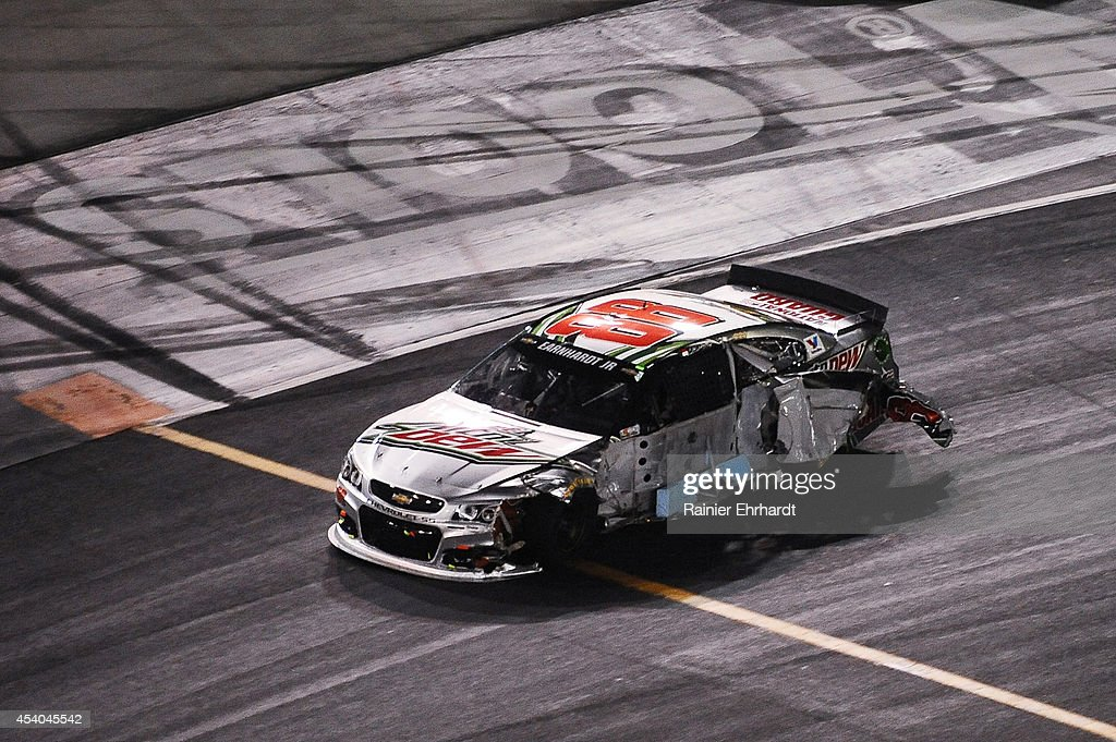 Dale Earnhardt Jr., driver of the #88 Diet Mountain Dew Chevrolet, is seen after an incident during the NASCAR Sprint Cup Series Irwin Tools Night Race at Bristol Motor Speedway on August 23, 2014 in Bristol, Tennessee.