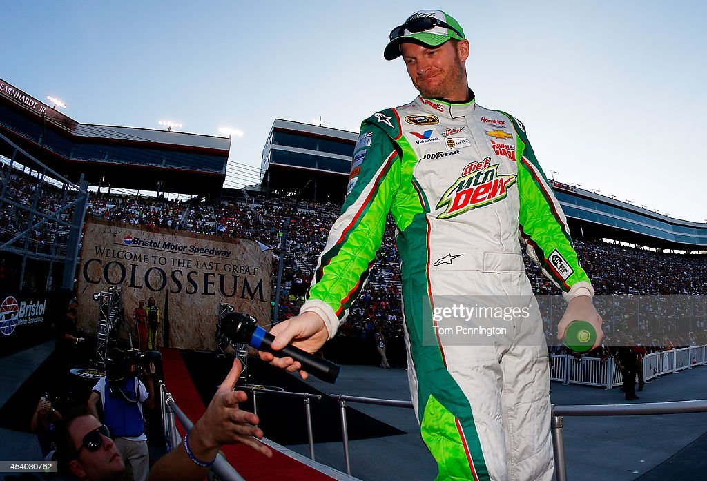 Dale Earnhardt Jr., driver of the #88 Diet Mountain Dew Chevrolet, is introduced before the NASCAR Sprint Cup Series Irwin Tools Night Race at Bristol Motor Speedway on August 23, 2014 in Bristol, Tennessee.