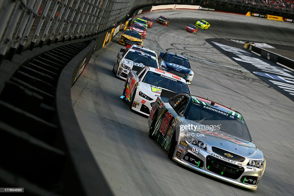 Dale Earnhardt Jr., driver of the #88 Diet Mountain Dew Chevrolet, leads a pack of cars during the NASCAR Sprint Cup Series 53rd Annual IRWIN Tools Night Race at Bristol Motor Speedway on August 24, 2013 in Bristol, Tennessee.
