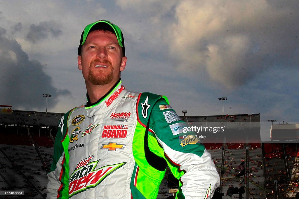 Dale Earnhardt Jr., driver of the #88 Diet Mountain Dew Chevrolet, looks on after qualifying for the NASCAR Sprint Cup Series IRWIN Tools Night Race at Bristol Motor Speedway on August 23, 2013 in Bristol, Tennessee.