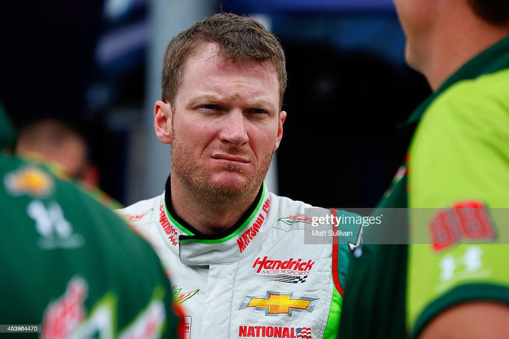Dale Earnhardt Jr., driver of the #88 Diet Mountain Dew Chevrolet, looks on in the garage area during practice for the NASCAR Sprint Cup Series Irwin Tools Night Race at Bristol Motor Speedway on August 22, 2014 in Bristol, Tennessee.