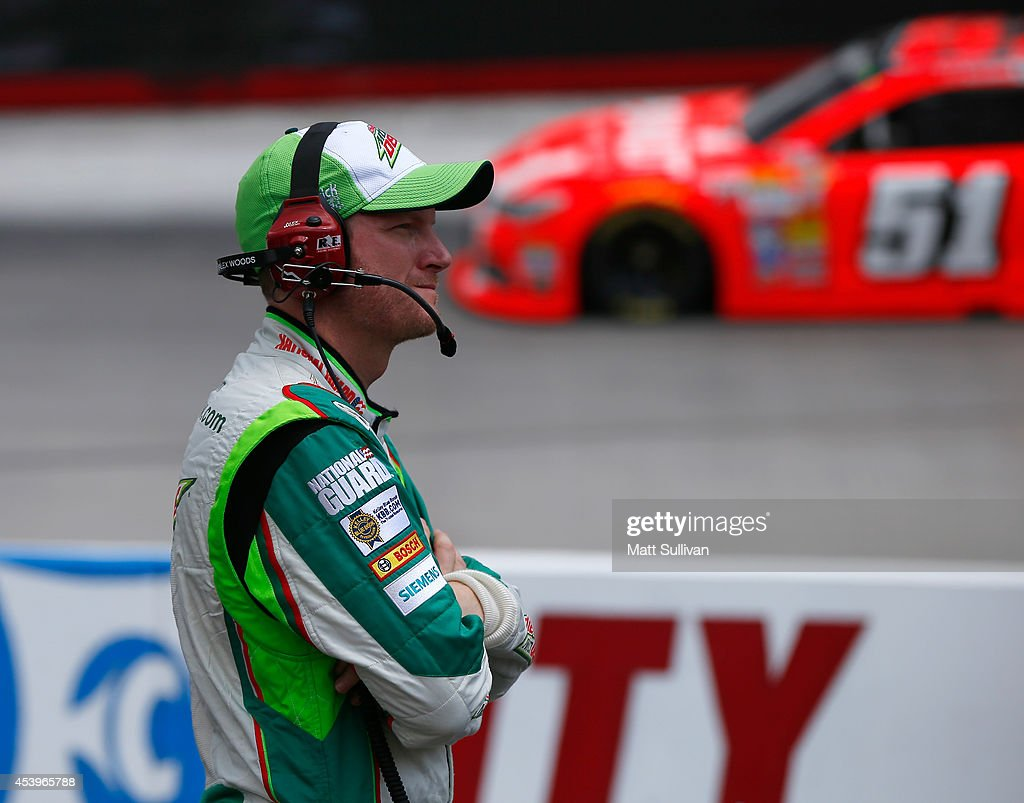 Dale Earnhardt Jr., driver of the #88 Diet Mountain Dew Chevrolet, looks on during practice for the NASCAR Sprint Cup Series Irwin Tools Night Race at Bristol Motor Speedway on August 22, 2014 in Bristol, Tennessee.