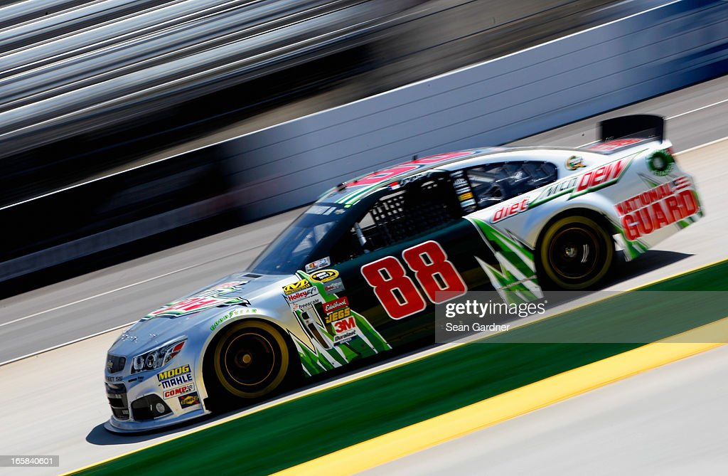 Dale Earnhardt Jr., driver of the #88 Diet Mountain Dew Chevrolet, practices for the NASCAR Sprint Cup Series STP Gas Booster 500 on April 6, 2013 at Martinsville Speedway in Ridgeway, Virginia.